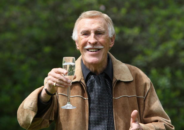 Bruce Forsyth at his home in 2011 in Wentworth, as he poses for photographers after he received a Knighthood in the Queen's Birthday Honours list.