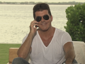 Simon Cowell telling the judges their categories on The X Factor.
