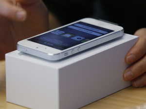 A customer tests the new iPhone 5 at the Apple store in Hong Kong