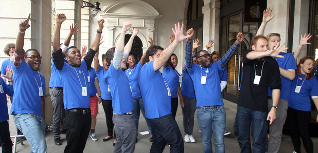 Apple staff giving the customers a welcome outside the Apple Store in Covent Garden