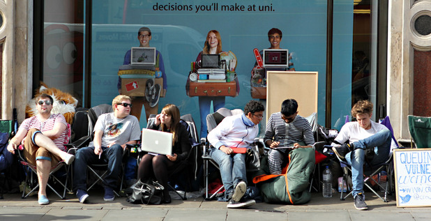 Queues gather outside the Apple store in Regent Street, London, ahead of the release of the iPhone 5 tomorrow morning.
