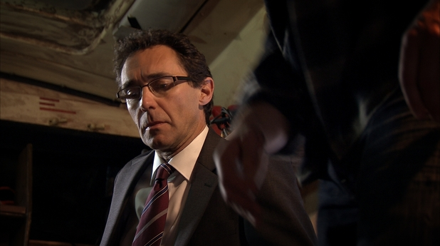 Henrik Hanssen (played by Guy Henry) being held hostage in a future episode of Holby City