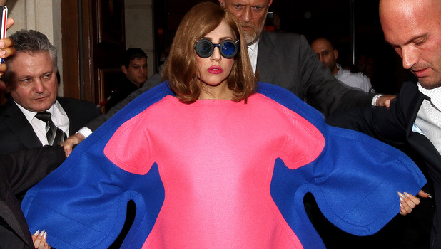 Lady Gaga is mobbed by photographers and fans as she leaves her Paris hotel in an oversized outfit, ahead of her concert. Due to the garment's size, Gaga's assistants had to pull her into the vehicle waiting for her, as she couldn't get in on her own Paris, France - 22.09.12 **Available for publication in the UK & USA only. Not for publication in the rest of the world** Mandatory Credit: WENN.com