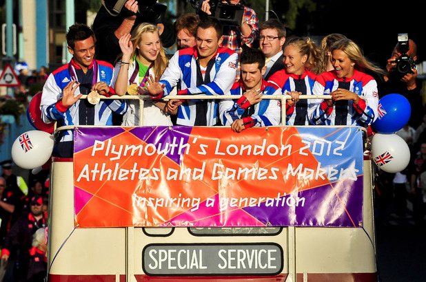 Plymouth based Olympic and Paralympic athletes, including Tom Daley (left) aboard an open top bus as they process through the streets of Plymouth, where thousands of people have turned out to welcome them home from the games (19/09/2012)