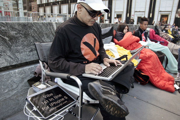 Hazen Sayer, an app developer, is first in line outside Apple's Fifth Avenue store on Thursday, Sept. 20, 2012, in New York. Sayer started camping out a week ago to be one of the first to get the new iPhone 5, which will go on sale in the U.S. and eight other countries next Friday, Sept. 21.