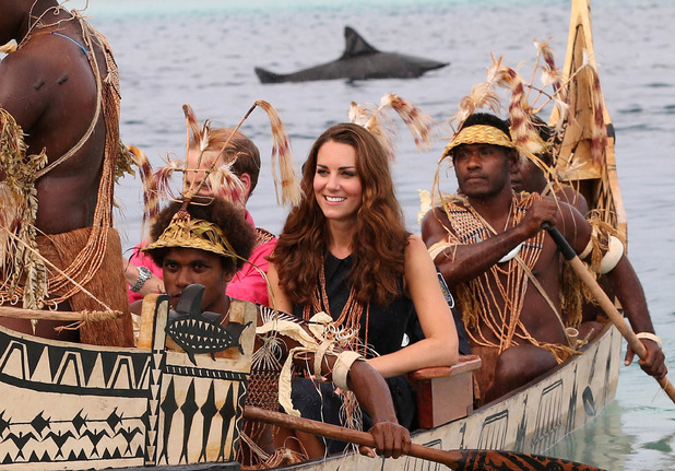 Kate Middleton, Duchess of Cambridge, travel in a traditional canoe during a visit to Tavanipupu Island