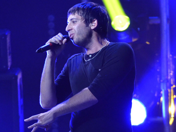Example performing at the iTunes Festival held at the Roundhouse