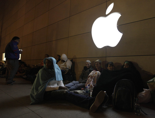 Meanwhile, customers in Chicago keep warm as they wait for the iPhone 5 to go on sale.