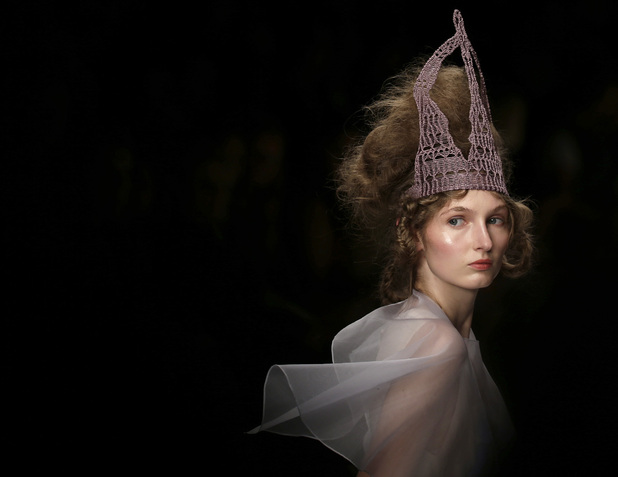 A model presents a design by Bora Aksu during his Spring/Summer 2013 show at London Fashion Week in London