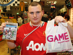 Martin Keenan from Gateshead is the first to buy a copy of FIFA 13 at GAME's Gateshead Metro Centre store in Newcastle Upon Tyne