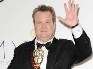 Eric Stonestreet with his Supporting Actor In A Comedy Series award at the 64th Annual Primetime Emmy Awards press room