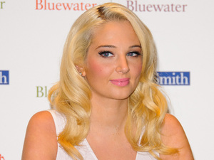 Tulisa Contostavlos signs copies of her autobiography 'Honest - My story so far' at WHSmith's, Bluewater shopping centre Kent, England - 26.09.12 Mandatory Credit: WENN.com