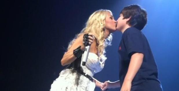 Carrie Underwood kisses 12-year-old fan Chase at a concert in Louisville