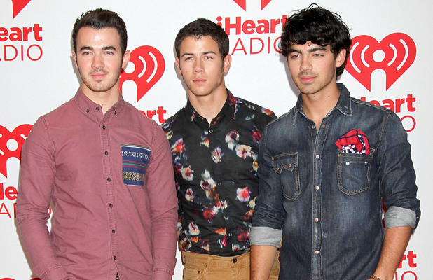 Kevin Jonas, Nick Jonas and Joe Jonas of The Jonas Brothers at the iHeart Radio Music Festival 2012