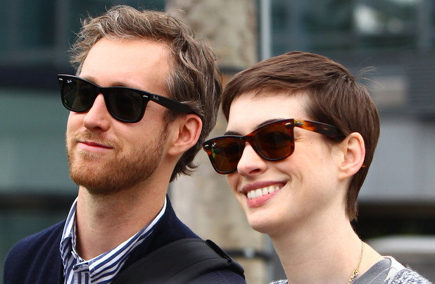 Anne Hathaway and Adam Shulman arriving at Heathrow Airport. Anne is in London for the premiere of 'The Dark Knight Rises' London, England - 18.07.12 Mandatory Credit: WENN.com