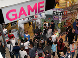 People are seen waiting topurchae the first copy of FIFA 13 at GAME's Gateshead Metro Centre store in Newcastle Upon Tyne