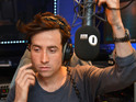 Broadcaster opens first Radio 1 breakfast show with Jay-Z and Kanye West track.