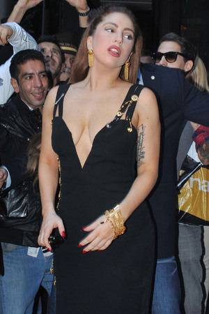 Lady Gaga is mobbed by fans as she leaves the Hotel Principe di Savoia in Milan Milan, Italy