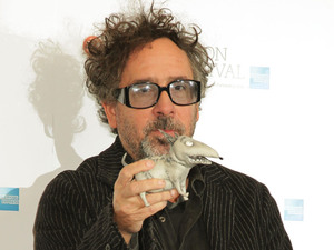Frankenweenie Premiere: Tim Burton holding a puppet of Sparky, a character from the movie