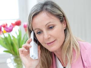 Women using a landline phone