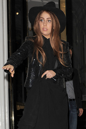 Lady Gaga leaves The Ecuadorian Embassy at midnight, having spent five hours inside visiting Wikileak's founder Julian Assange. Gaga made no comment as she left the premises. London, England
