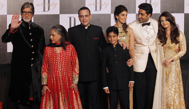 Amitabh Bachchan, left, gestures as he poses for photographs along with family members, wife Jaya Bachchan, second left, son-in-law Nikhil Nanda, third left, daughter Shweta Nanda, third right, son Abhishek Bachchan, second right, and daughter-in-law Aishwarya Rai-Bachchan during a party on the eve of his 70th birthday in Mumbai, India