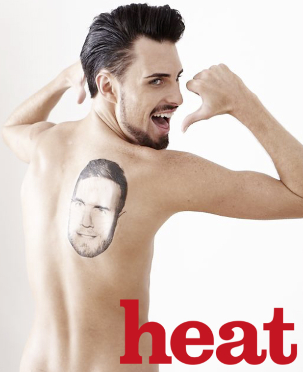 X Factor star Rylan Clark shows off his Gary Barlow tattoo.