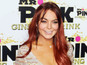 Lindsay Lohan reacts to half-sister