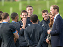 Kate Middleton & Prince William meet England squad at National Football Centre.