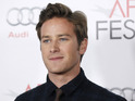 Actor Armie Hammer poses for photographers after the Young Hollywood Panel during AFI FEST 2011 in Friday, Nov. 4, 2011, in Los Angeles.