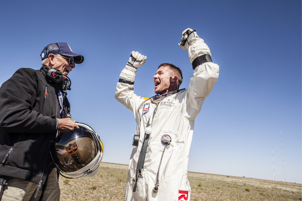 Felix Baumgartner celebrates his successful skydive with Red Bull Stratos life support engineer Mike Todd - New Mexico, October 14, 2012