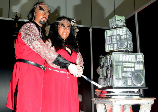 Jossie Sockertopp, 23 (right) and Sonnie Gustavsson, 29, from Sweden tie the knot in full Klingon costume as their Star Trek idols, during a ceremony conducted by Peter Wyllie in the Klingon language, at Destination Star Trek at the ExCel Centre in London.