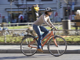 Woman on bicycle cycling through town
