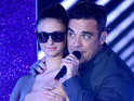Robbie Williams performs on Italian X Factor with topless dancers - pictures.