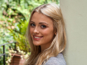 Wallis Day as Holly Cunningham