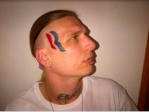 Avid Mitt Romney supporter Eric Hartsburg who has posted a picture on Twitter with the Romney campaign logo tattooed on his head