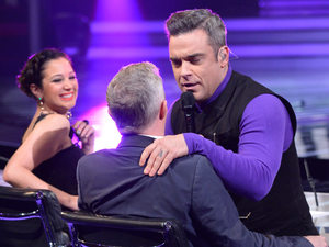 The X Factor Results Show: Robbie Williams and Louis Walsh.