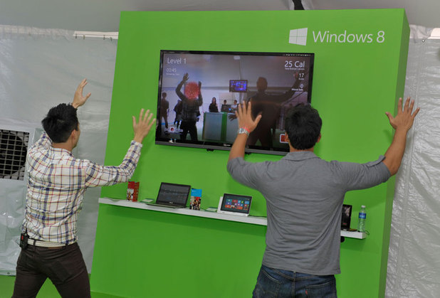 Attendees try out new devices at Microsoft Corp.'s regional launch of Windows 8 in Singapore on Thursday, Oct. 25.