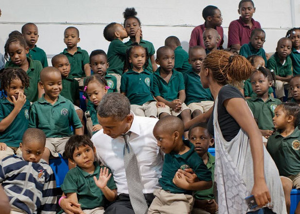 Photo posted by @BarackObama, in which he is 'photobombed' by a pupil kissing a fellow pupil in the background
