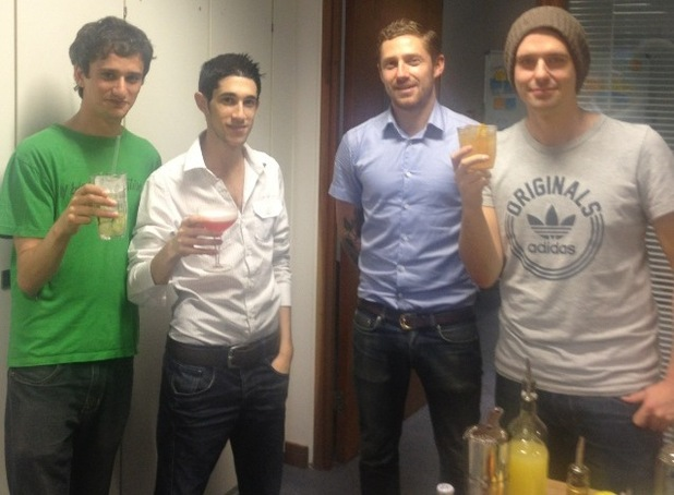 Digital Spy pose with their cocktails