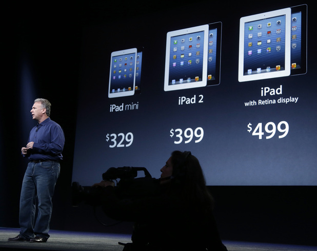 Phil Schiller, Apple's senior vice president of worldwide product marketing, displays the prices of the company's various iPad products