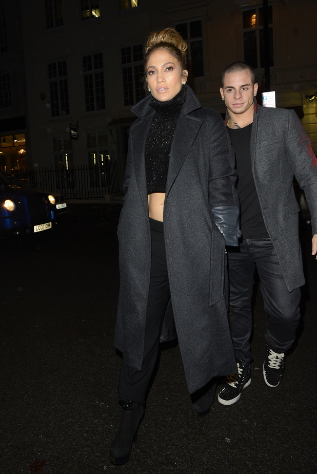 Jennifer Lopez showed off her abs as she returned to the Claridges hotel with boyfriend Casper Smart