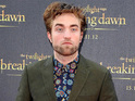 Robert Pattinson attends Twilight premiere, says Kristen Stewart is 'excited'.