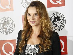 British singer Nadine Coyle arrives at the Q Music Awards 2010 at Grosvenor House, central London, Monday Oct. 25, 2010.