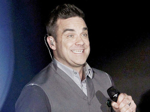 Robbie Williams performs on the Italian X Factor show Milan, Italy - 18.10.12 **Available for publication in UK, Germany, Austria, Switzerland. Not available for publication in the rest of the world** Mandatory Credit: Andrea Raffin/WENN.com