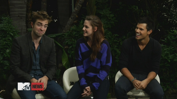 Robert Pattinson, Kristen Stewart and Taylor Lautner Twilight co-stars Kristen Stewart and Robert Pattinson reunite to give their first joint interview since the actress admitted to romancing her married Snow White and the Huntsman director Rupert Sanders in July (12). Stewart has since reconciled with Pattinson, and the couple were joined by co-star Taylor Lautner as they chatted to MTV about the franchise finale, The Twilight Saga: Breaking Dawn - Part 2. USA - 01.11.12, Supplied by WENN.com(WENN does not claim any Copyright or License in the attached material. Any downloading fees charged by WENN are for WENN's services only, and do not, nor are they intended to, convey to the user any ownership of Copyright or License in the material. By publishing this material, the user expressly agrees to indemnify and to hold WENN harmless from any claims, demands, or causes of action arising out of or connected in any way with user's publication of the material.)
