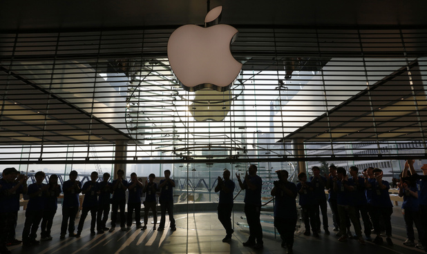 A security guard stands next to an area expected for customers to queue up at the Apple store in Hong Kong