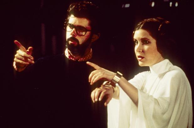 George Lucas directs Carrie Fisher on the set of Star Wars: A New Hope.