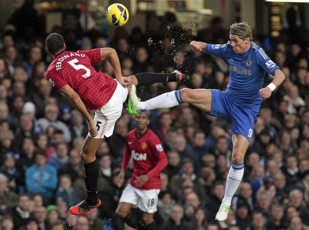 Manchester United&#39;s Rio Ferdinand and Chelsea&#39;s Fernando Torres