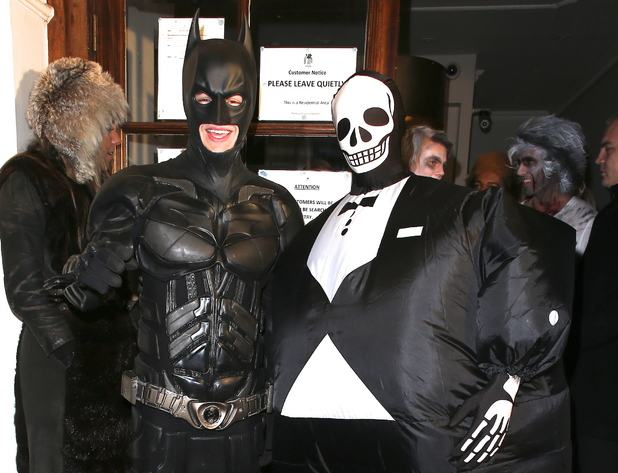 Liam Payne of One Direction dressed as Batman and Tom Daley in a fat skeleton costume Celebrities at Funky Buddha nightclub for a Halloween party London, England